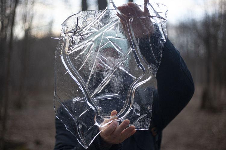Close-up of man holding ice