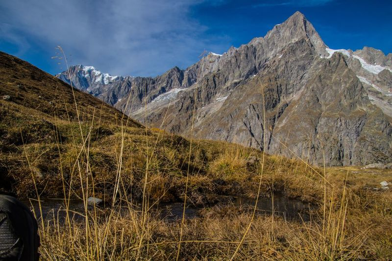 refuge bonatti,courmayeur,italy Mountain Sky Mountain Range Scenics - Nature Nature Environment Landscape Cloud - Sky Beauty In Nature Plant Tranquil Scene Tranquility Day Non-urban Scene Grass Land No People Outdoors Rock Mountain Peak Formation