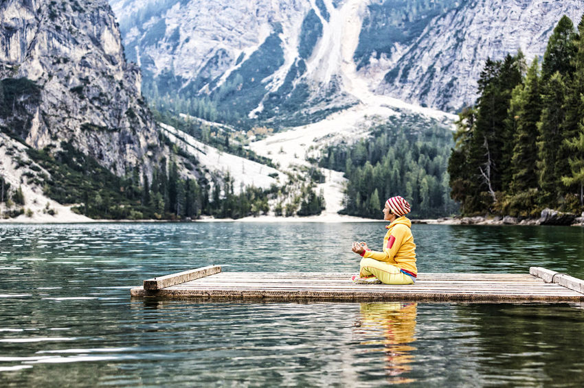 Yoga at the lake Adventure Alone Asana Asanas Beauty In Nature Calm Dolomites Enjoy Float Lake Meditation Mind  Mindfulness Moment Mountain Nature One Person Outdoors Pose Prags Pragser Wildsee Raft Recreation  Scenery Yoga Miles Away The Great Outdoors - 2017 EyeEm Awards