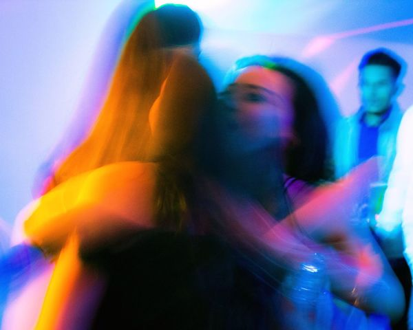 Two People Togetherness Indoors  Multi Colored Real People Young Women Lifestyles Celebration Colour Of Life Colorful Colors Dance Fun Long Exposure Party Hug Embracing Women Men Nightlife Young Adult Night Adult People Live For The Story Place Of Heart