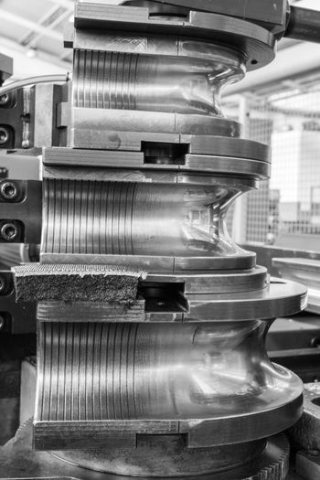 Machinery Business Metal Industry Technology Factory Equipment Blurred Motion No People Manufacturing Equipment Close-up Motion Indoors  Machine Part Manufacturing Stack Metal Industry Focus On Foreground Speed Industrial Building  Steel Alloy Silver Colored Economy Industrial Equipment Bending Machine