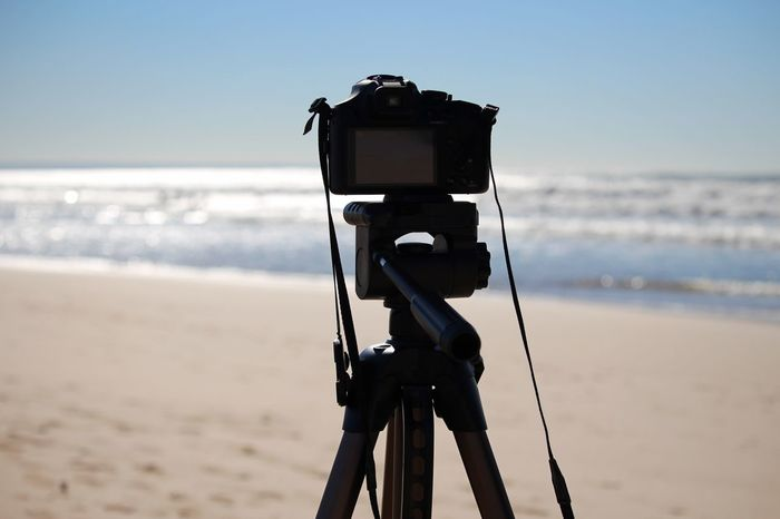 Beachphotography Camera Tripod Minimalobsession Waves Crashing People Watching Waves, Ocean, Nature Photographic Equipment EyeEm Gallery EyeEm Best Shots EyeEmBestPics Sky And Clouds Eye4photography  My Point Of View Seaside Taking Photos at Praia De Carcavelos Portugal