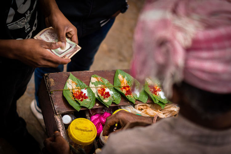 Cropped image of man making paan
