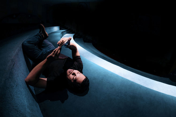 Man using phone while lying down