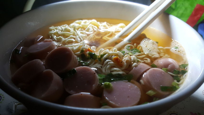 Keeping it simple ... sausage and instant noodles in Vietnam. Bowl Food Indoors  Close-up Vietnam Dining Noodles Snacks! Instant Noodles Sausage
