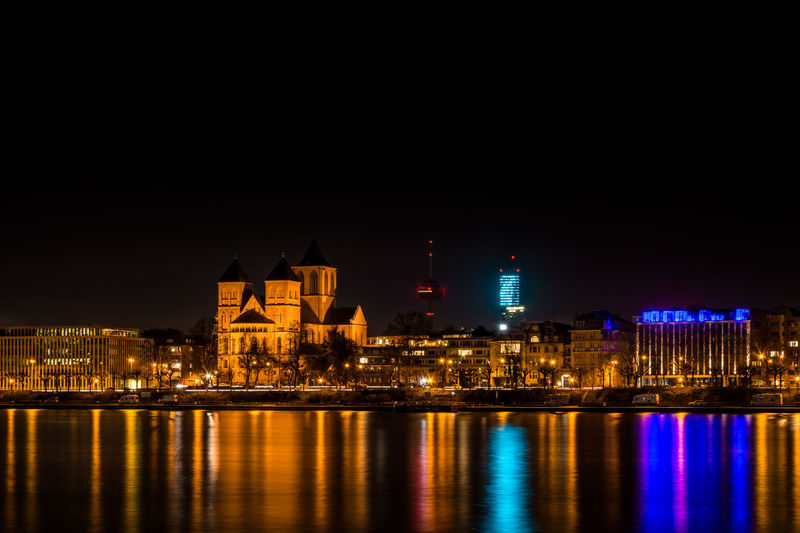 This picture shows the skyline of Cologne at night with the Basilica St. Cunibert, the Cologne Tower and the Colonius from the banks of the river Rhine. Architecture Church City Cityscape Cologne Cologne , Köln,  Illuminated Köln Kölnturm Landmark Night Night Lights Night Photography Nightphotography Reflection Reflection Reflections In The Water Rhein Rhine Sky Skyline St. Kunibert Tower Travel Destinations Urban Skyline