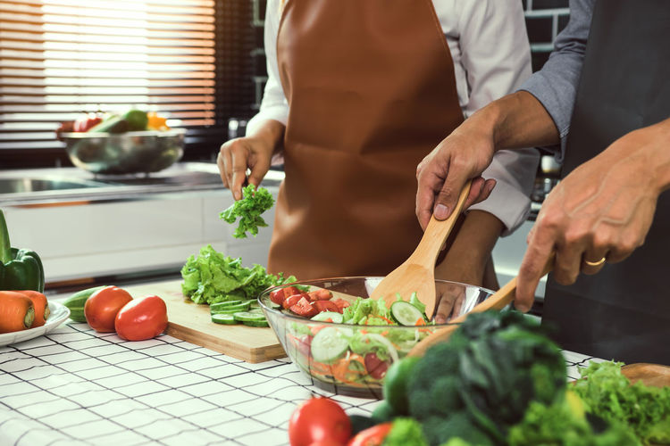 Midsection of man preparing food at home