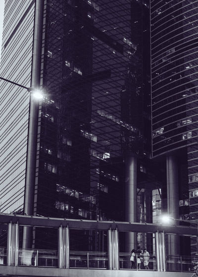 Hong Kong Streets Hong Kong Hong Kong City Architecture Building Building Exterior Built Structure City Communication Financial District  Illuminated Light Lighting Equipment Low Angle View Modern Night No People Office Office Building Exterior Outdoors Skyscraper Street Street Light Streetphotography Tall - High Text