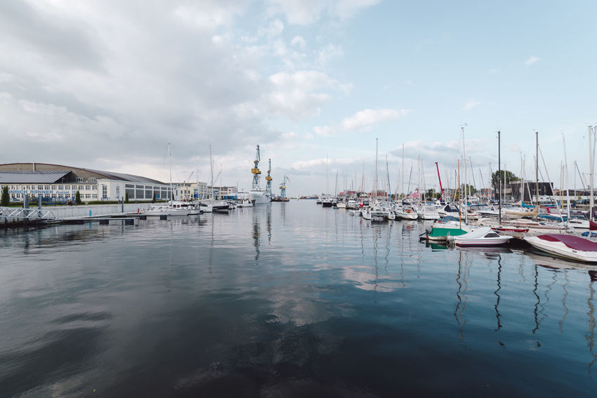 boats moored at harbor against sky Baltic Sea Mecklenburg-Vorpommern Travel Wismar Harbor Architecture Cloud - Sky Day Germany Hanseatic Harbor Mast Mode Of Transport Moored Nature Nautical Vessel No People Ocean Outdoors Reflection Sea Sky Transportation Water Waterfront Wismar Yacht