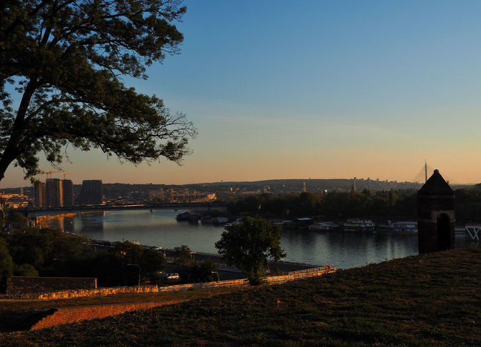 European Cities Belgrade Serbia Eastern Europe Balkans Europe Outdoors Travel Photography Travel Destinations Sunset River View River Water Horizon Sky Architecture Built Structure Building Exterior Nature Plant Tree No People Reflection City Clear Sky