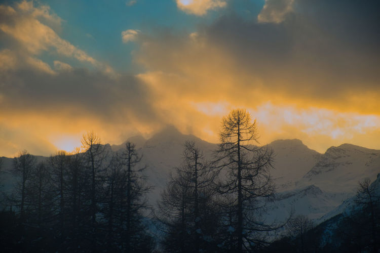sunset start. Azzurro Beauty In Nature Blu And Yellow Cloud - Sky Cold Temperature Day Landscape Mountain Nature No People Outdoors Scenics Sky Snow Sunset Tranquil Scene Tranquility Tree Winter