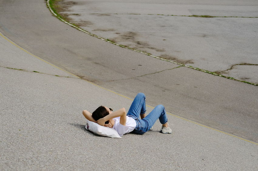 Asphalt sunbath High Angle View Day Mature Adult Full Length Outdoors Lying Down Adult Young Adult Casual Clothing Fashion The Street Photographer - 2017 EyeEm Awards Out Of The Box Place Of Heart The Great Outdoors - 2017 EyeEm Awards The Portraitist - 2017 EyeEm Awards The Architect - 2017 EyeEm Awards EyeEmNewHere EyeEm Selects