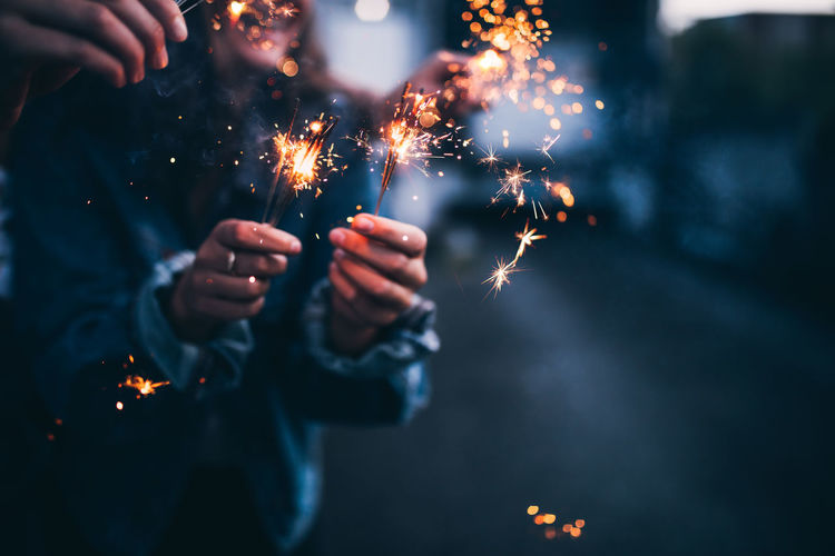 Celebration Holiday Burning Celebration Event Fire Firework Firework Display Focus On Foreground Glowing Human Hand New Years Eve Night Real People Sparkler Sparks
