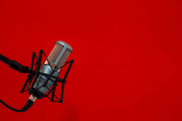 Microphone on Red background Red Copy Space Indoors  Microphone Colored Background No People Input Device Studio Shot Arts Culture And Entertainment Music Communication Red Background Technology Studio Metal Man Made Object Equipment Black Color Performance Man Made Speech Stage