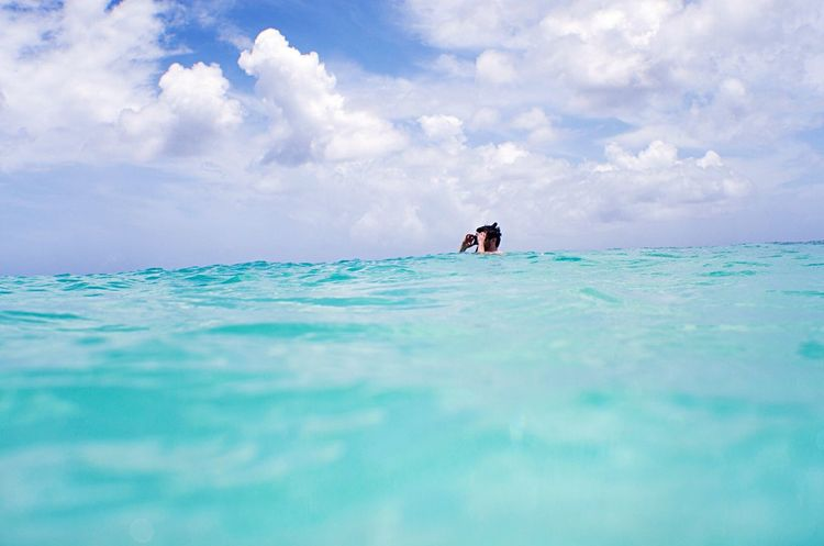 Sky Snorkeling Snorkel Cloud - Sky Water Sea Scenics Tranquility Tranquil Scene Horizon Over Water Swimmer Swimming Blue Aqua Diver Ocean Sea And Sky Carribean Day Vacations Outdoors Lifestyles Beach Open Water Adventure