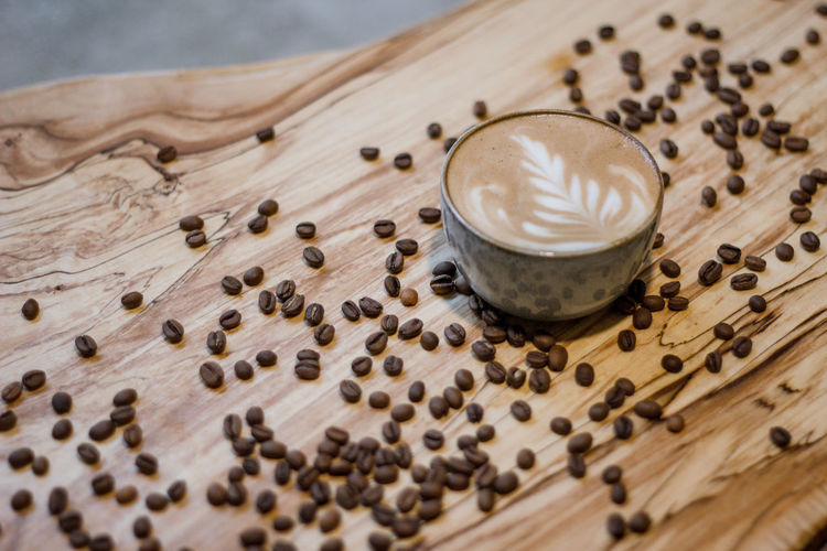 Coffee Coffee - Drink Coffee Cup Coffee Time Coffee Break Food And Drink Indoors  No People Drink Refreshment Wood - Material Roasted Coffee Bean Table Food Freshness High Angle View Cappuccino Still Life Mug Latte Frothy Drink Hot Drink Glass Caffeine Crockery