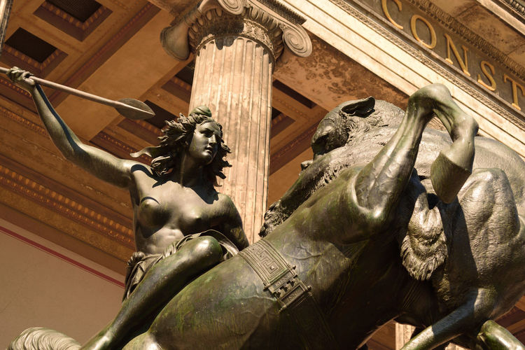 Lionsfight at berlin altes museum Amazing Architecture Amazone Architecture Berlin Berliner Ansichten Day History Low Angle View No People Nudityisfreedom Outdoors Sculpture Statue Strong Woman Travel Destinations Woman Woman Power Discover Berlin