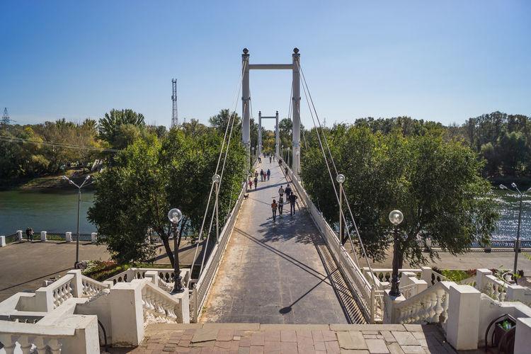 Scenic view of footbridge against clear sky