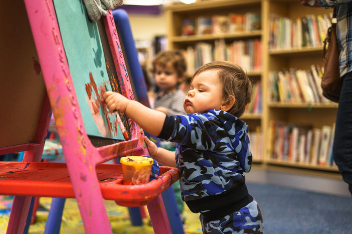 At Shoelane Library Art And Craft Artist Blonde Bookshelf Canvas First Library Messy Art Boy Brush Camouflage Clothing Curiosity Cute Focus On Foreground Leisure Activity Painter Painting Toddler  Toddler Boy Toddlerlife This Is Masculinity