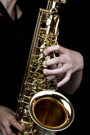 Music Instrument Alto Saxophone Player, Saxophone Player Isolated on black Music Musical Instrument Human Hand Hand Artist Playing Musician Arts Culture And Entertainment Saxophone One Person Performance Human Body Part Holding Brass Instrument  Real People Musical Equipment Skill  Men Gold Colored Finger Black Background