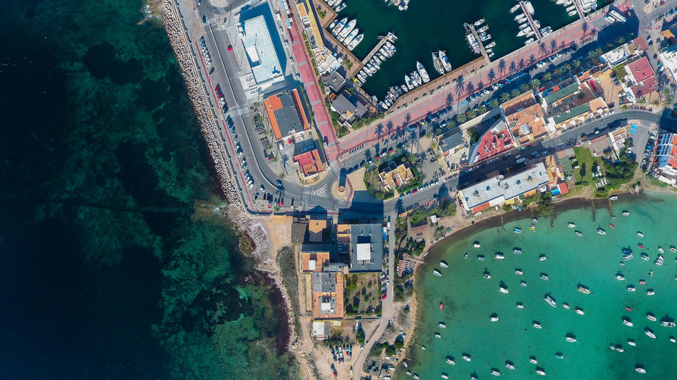 Drone  Harbor Aerial View Architecture Blue And Green Blue Water Boats Building Built Structure Day Dronephotography Green Water High Angle View Mode Of Transportation Ocean Port Road Sea Ships Street Tree Water