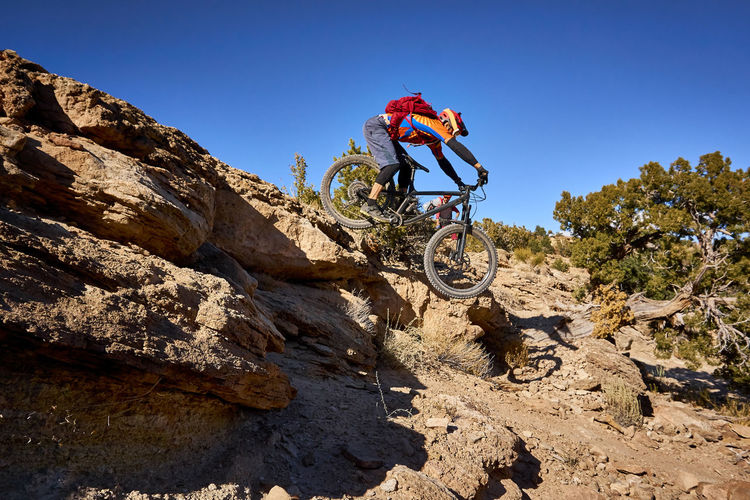 Man riding bicycle on rock