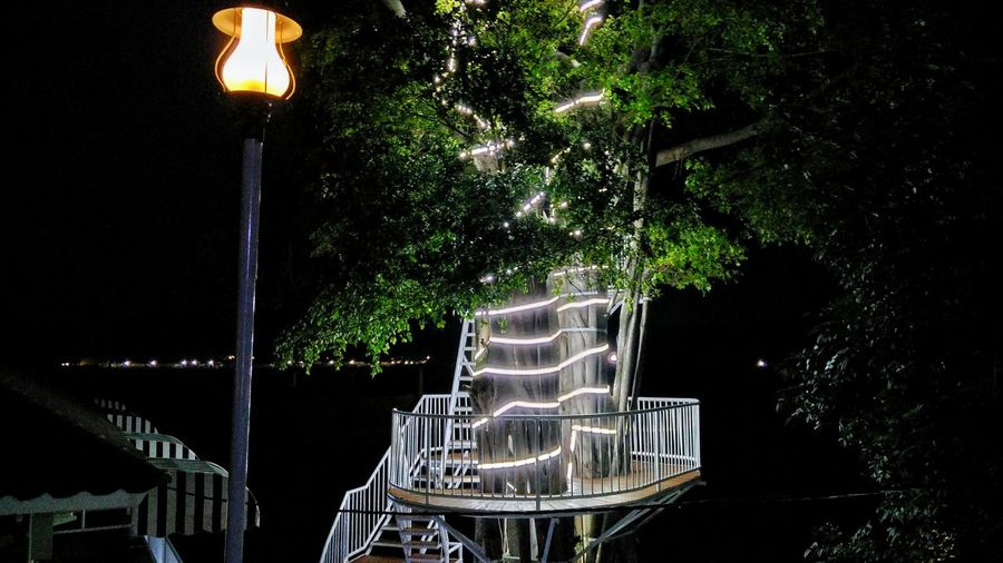 Empty chairs in park at night