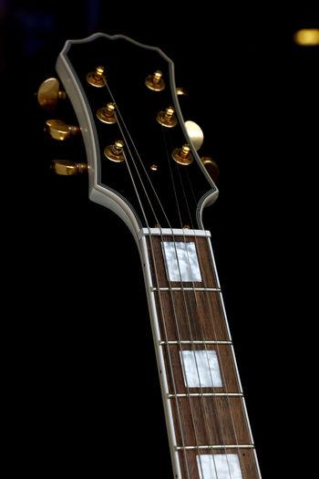 Electric Guitar Fretboard Neck Close Up Over Black Background Dark Les Paul Rock Arts Culture And