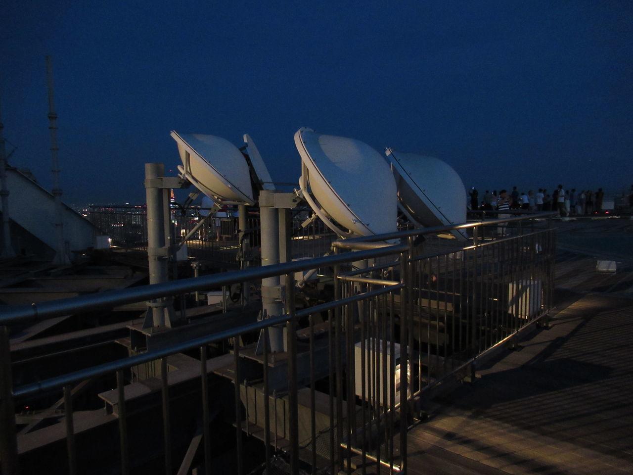 MODERN BUILDINGS AGAINST SKY AT NIGHT