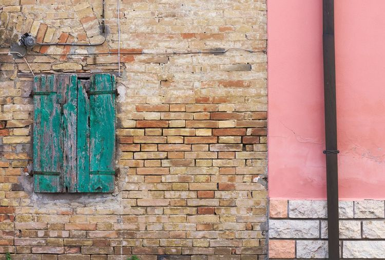 Architectural details in Italy Architecture EyeEm Best Shots EyeEmNewHere Façade The Week On EyeEm Architecture Brick Wall Building Exterior Built Structure Day Door Facade Building No People Outdoors Window