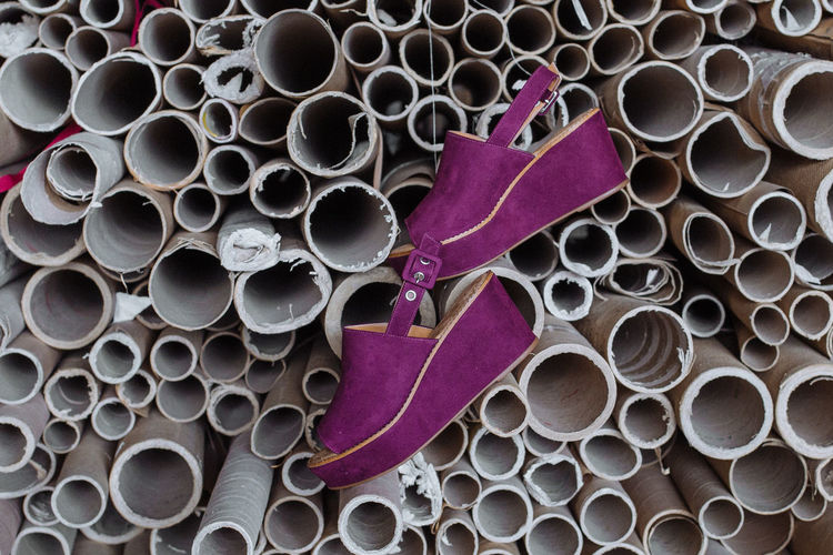 Purple shoes hanging from pipes