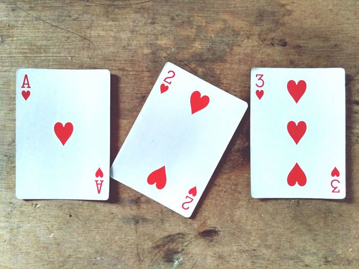 Directly above shot of playing cards on wooden table