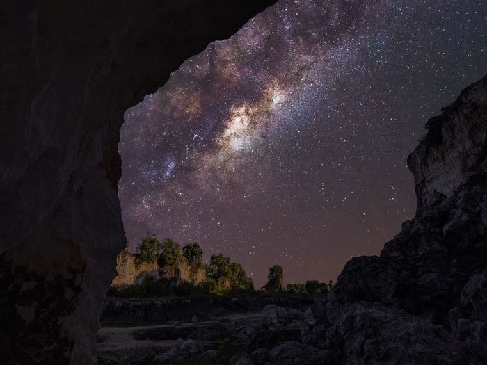 Rock formations against sky at night