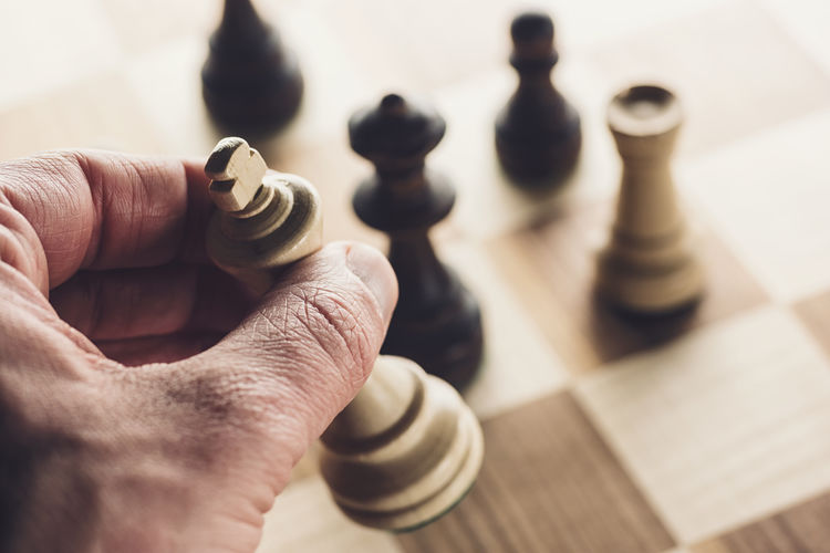 playing wooden chess pieces Business Field Games Individuality King Planning Agression Board Board Game Challenge Chess Chess Board Chess Piece Competition Conflict Decision Defence Game Hand Marketing Mind  Move Parliamentary Play Stragedy
