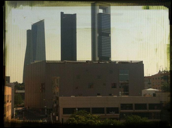 En un sólo vistazo: edificios de viviendas y locales, una base de bomberos, un polideportivo, edificios de oficinas... Madrid Spanish Arquitecture PicFeeling GetYourGuide Cityscapes