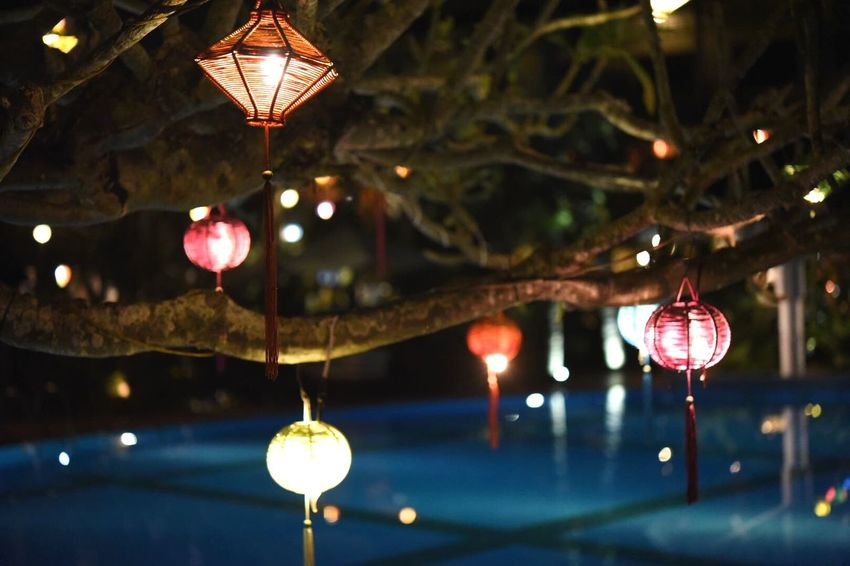 Relaxing Poolside Hanging Illuminated Lighting Equipment Lantern Night Focus On Foreground No People Close-up
