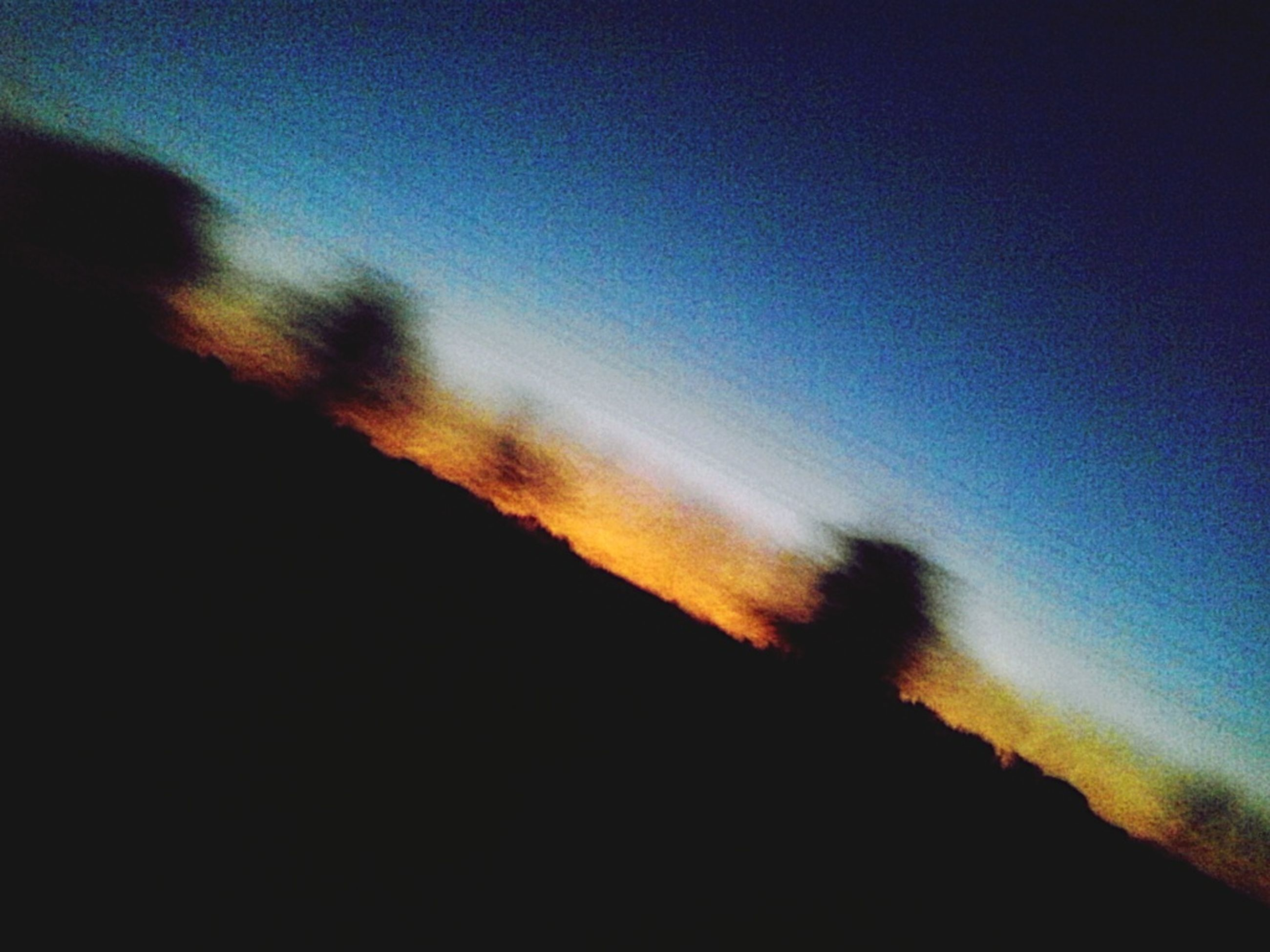 silhouette, sunset, sky, scenics, beauty in nature, tranquility, tranquil scene, low angle view, nature, dusk, copy space, cloud - sky, dark, blue, idyllic, outdoors, outline, cloud, no people, dramatic sky