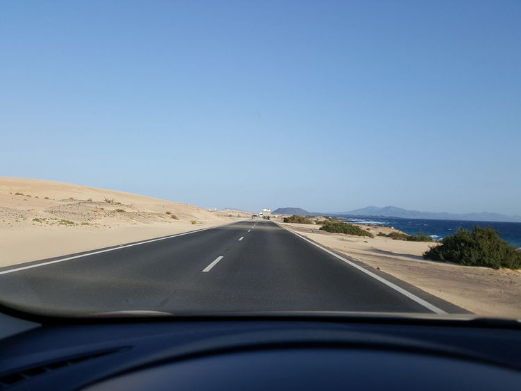 Car Transportation Windshield Road Travel Blue On The Move The Way Forward Driving Clear Sky Vehicle Interior Mode Of Transport Sky Landscape Dunes Corralejo Road To Corralejo Corralejo, Fuerteventura On The Road On My Way Blue Sky Road Roadtrip Clear Sky Free Road
