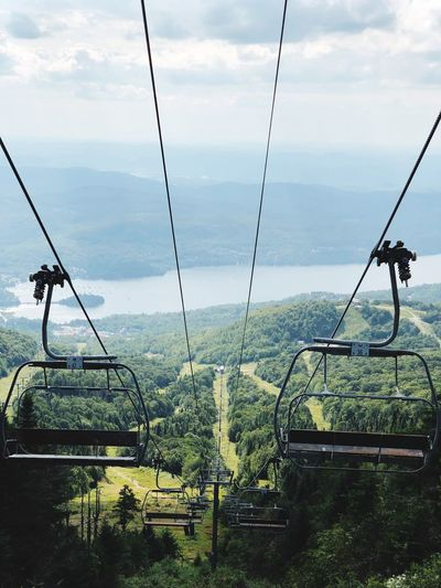 Mont Tremblant Gondola Lift Mountain Sky Nature No People Day Plant Tranquility Cloud - Sky Outdoors Playground Swing Land Beauty In Nature Tranquil Scene Water Empty Hanging Field Growth Scenics - Nature Outdoor Play Equipment