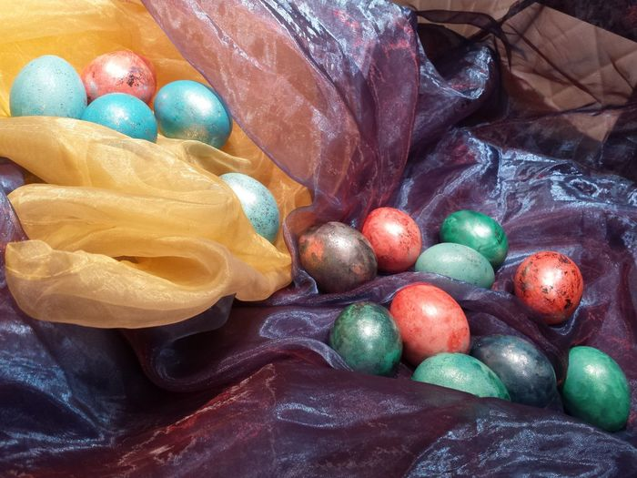 Close-Up Of Easter Eggs On Colorful Fabrics