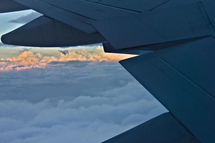 Sunset view from a plane window. Wing Air Vehicle Aircraft In The Sky Aircraft View Aircraft Wing Airplane Cloud - Sky Clouds Cloudscape Day Flying Mid-air Mode Of Transportation Nature No People on the move Outdoors Plane Window Plane Wing Sky Sun Clouds Sky Sunset Transportation Travel Vehicle Part