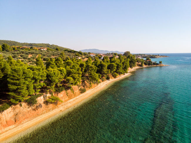 Chalkidiki coastline Drone  Mavic Air Wonderful Aerial Photography Aerial View Beach Beauty In Nature Blue Water Blue Water Blue Sky Chalkidiki Clear Sky Day Land Landscape Nature No People Outdoors Pine Woodland Scenics - Nature Sea Shore Shoreline Sky Tranquil Scene Water