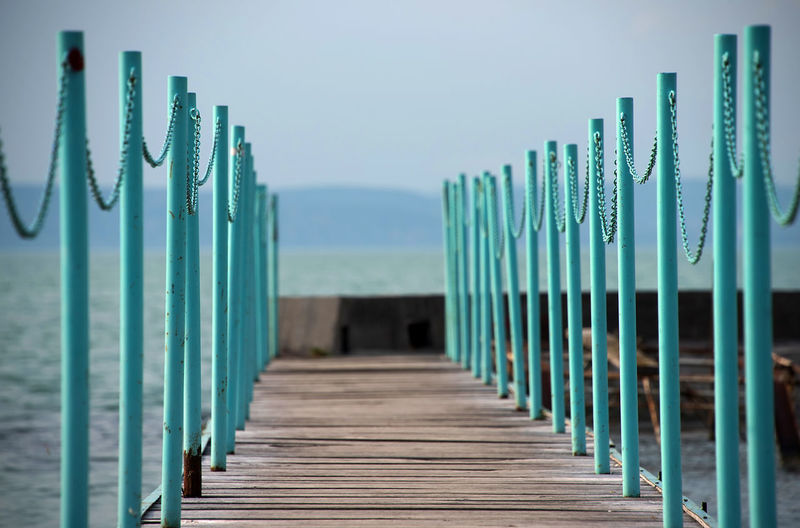 Close-Up Of Wooden Jetty At Beach Against Sky