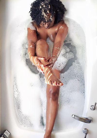 High Angle View Of Woman Taking Bath
