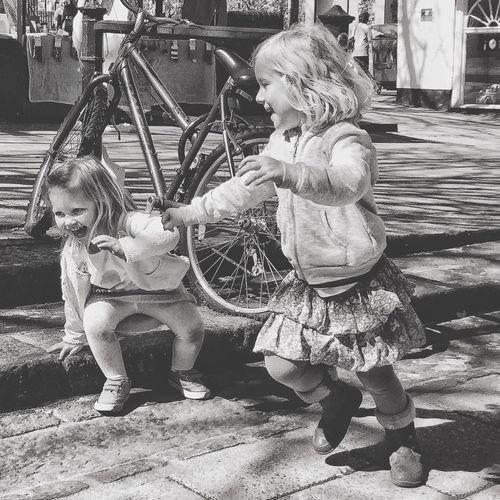 The Street Photographer - 2017 EyeEm Awards Girls Childhood Blond Hair Natural Pic Playing Games Laughing Havingfun