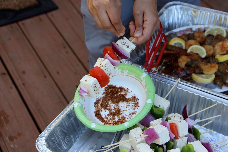 High Angle View Of Person Preparing Skewer