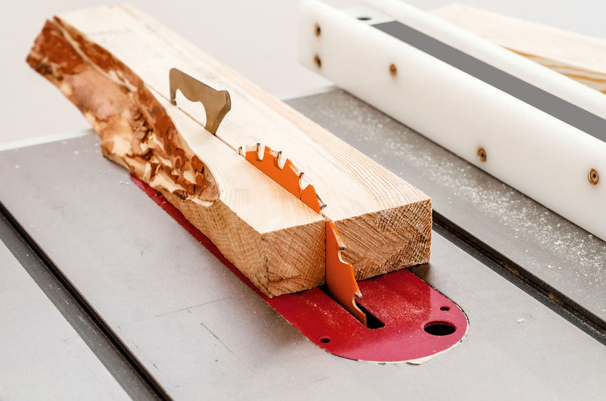 Cutting the board on a circular saw in a woodworking workshop Art And Craft Close-up Creativity Focus On Foreground Food Food And Drink High Angle View Indoors  No People Paper Pencil Shape Snack Still Life Sweet Sweet Food Table Toy White Color Wood - Material