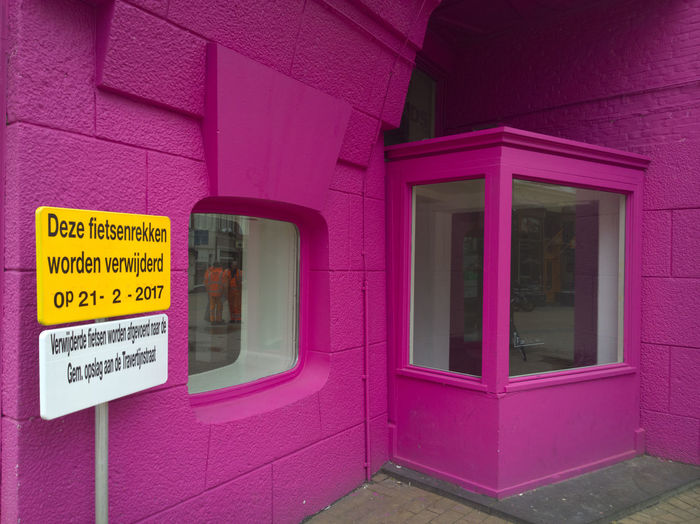 Text on pink window