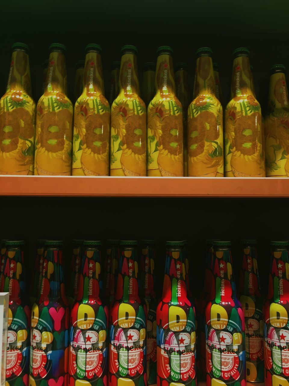 container, large group of objects, arrangement, choice, indoors, shelf, variation, in a row, no people, still life, abundance, retail, bottle, order, side by side, store, food and drink, multi colored, shelves, collection, retail display, sale