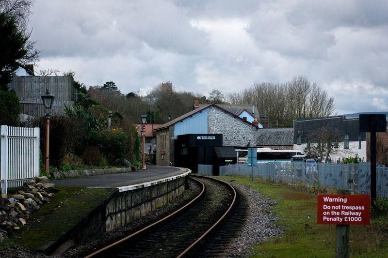 Watchet train line Watchet Somerset Gravel Railway Blue Walkway Grass Cloudy Cloud - Sky Old Town Old Historic Train Station Train Tracks Built Structure Sky Architecture Cloud - Sky Building Exterior House Railroad Track Day No People Outdoors Tree Railway Track